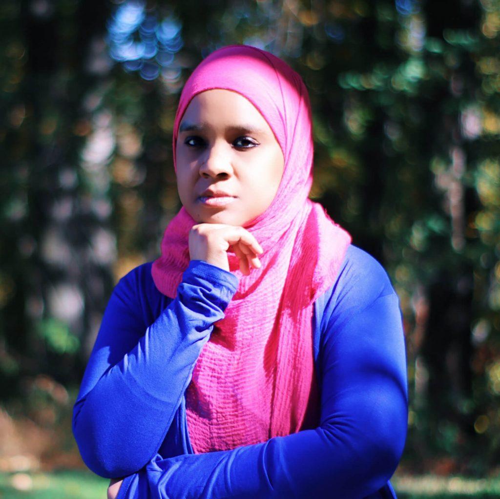 Umm Zakiyyah in pink hijab